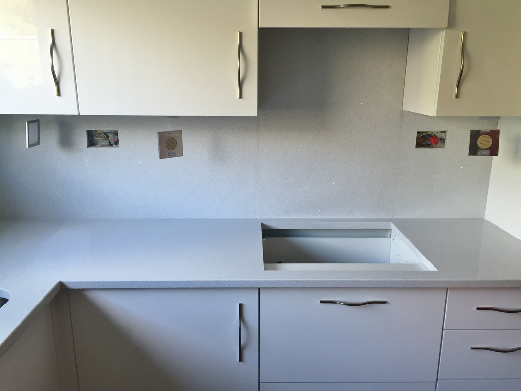 Starlight white mirror quartz the marble warehouse installation of starlight white quartz worktops with full height splashbacks including socket cut outs in bridgend 12th may 2015 dailygadgetfo Gallery