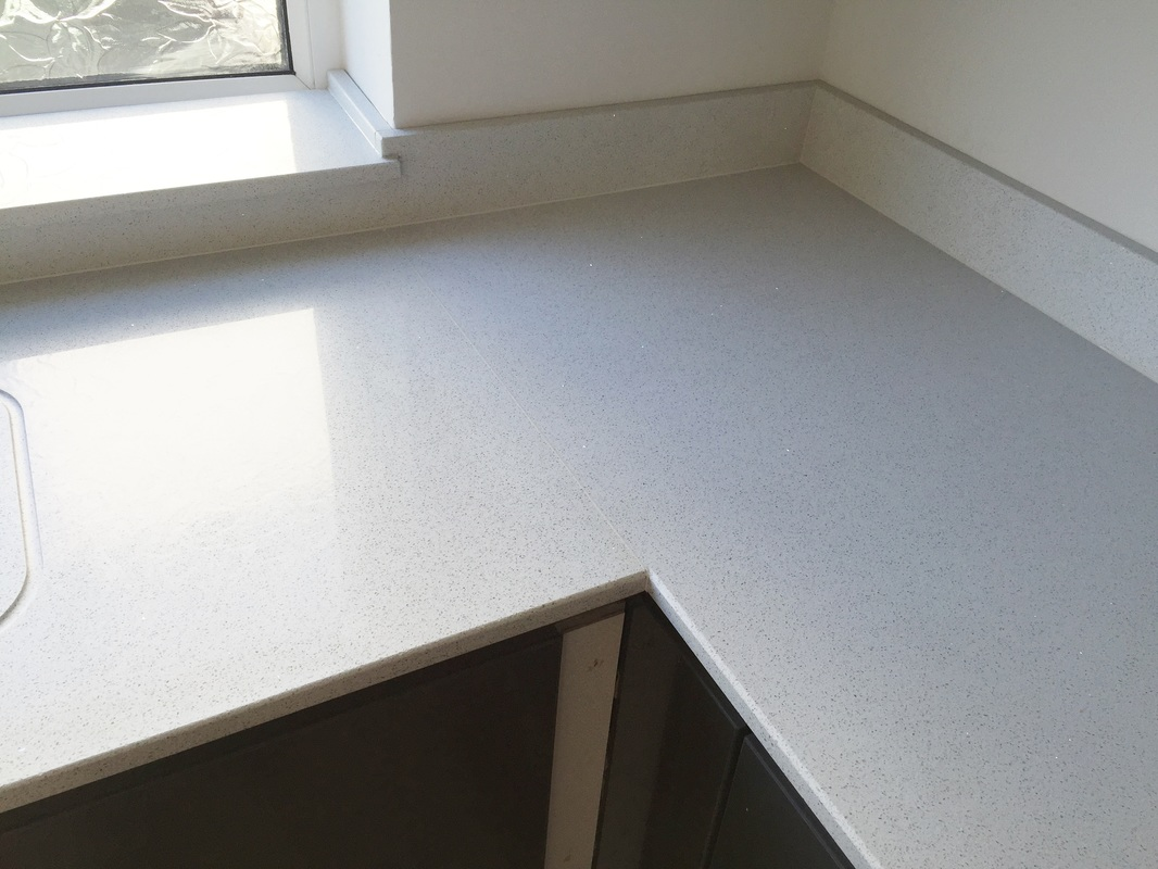 Starlight white mirror quartz the marble warehouse installation of 20mm thickness starlight white mirror quartz worktops in cardiff 10th july 2015 dailygadgetfo Gallery